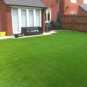 Garden completed in playtime artificial grass £12 square metre, 4 mt wide plus ground work.